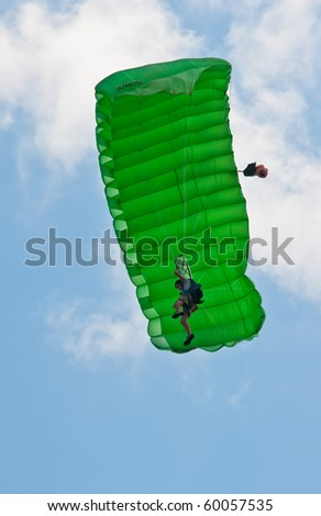 ZAGREB, CROATIA - AUG 29: A parachuter performing at Zagreb Air Show 2010  on Aug 29, 2010 in Zagreb, Croatia. The air show is held in celebration of a century of aviation  in Croatia.