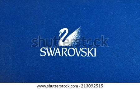ZAGREB , CROATIA - AUGUST 24 , 2014 : Swarovski jewelry brand logo close up , product shot