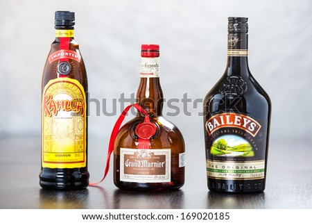 ZAGREB, CROATIA - DECEMBER 29, 2013: Bottles of coffee liqueur Kahlua, triple sec Grand Marnier and Bailey's Irish Cream, which in equal parts form B-52 cocktail, usually served layered in shot glass.