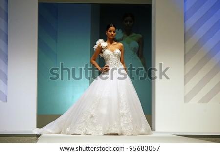 ZAGREB, CROATIA - FEBRUARY 19: Fashion model walks the runway in wedding dress on 'Wedding days' show, February 19, 2012 in Zagreb, Croatia. - stock photo