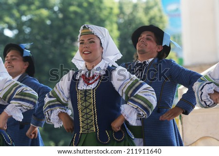 ZAGREB, CROATIA - JULY 18: Folk group Selkirk, Manitoba, Ukrainian Dance Ensemble Troyanda from Canada during the 48th International Folklore Festival in center of Zagreb, Croatia on July 18, 2014 #211911640