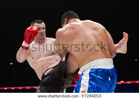 ZAGREB, CROATIA - MAR 10: K1 match between Mirko Cro Cop Filipovic (red gloves) vs. Ray Sefo (blue gloves) at Final Fight tounament on March 10, 2012 Zagreb, Croatia.