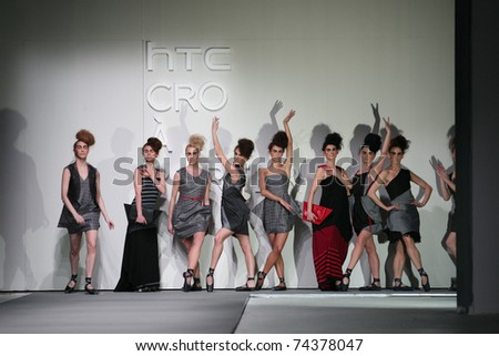 ZAGREB, CROATIA - MARCH 31: Fashion models in clothes made by Etna Maar on 'Croaporter' fashion show, March 31, 2011 in Zagreb, Croatia. - stock photo
