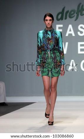"ZAGREB, CROATIA - MAY 11: Fashion model wears clothes made by HERMIONE DE PAULA on ""ZAGREB FASHION WEEK"" show on May 11, 2012 in Zagreb, Croatia."