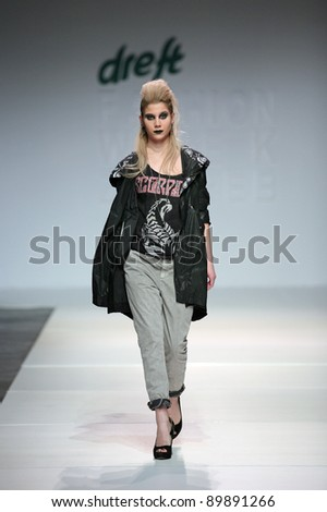 ZAGREB, CROATIA - NOVEMBER 25: Fashion model wears clothes made by Bad Spirit on 'Fashion Week Zagreb' show on November 25, 2011 in Zagreb, Croatia.
