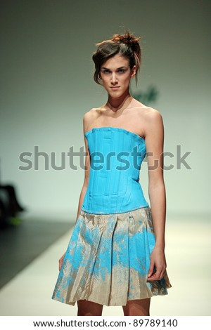 ZAGREB, CROATIA - NOVEMBER 24: Fashion model wears clothes made by Karim Bonnet on 'Fashion Week Zagreb' show on November 24, 2011 in Zagreb, Croatia.