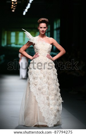 ZAGREB, CROATIA - OCTOBER 20: Fashion model wears clothes made by Boris Pavlin in 'Croaporter' show on October 20, 2011 in Zagreb, Croatia.