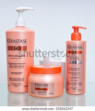 ZAGREB , CROATIA - SEPTEMBER 16 , 2014 -  Kerastase hair products , shampoo, mask, hairspray on the table , product shot