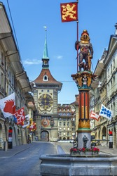 Zahringerbrunnen (Zahringen Fountain)  and Zytglogge tower in Bern downtown, Switzerland