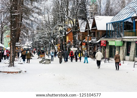 ZAKOPANE - JANUARY 07: Shops along the Krupowki street in Zakopane in Poland on January 07, 2012. Krupowki street is the main shopping area and pedestrian promenade in the center of Zakopane