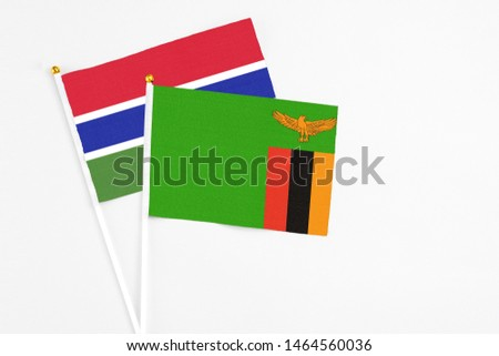 Zambia and Georgia stick flags on white background. High quality fabric, miniature national flag. Peaceful global concept.White floor for copy space. #1464560036