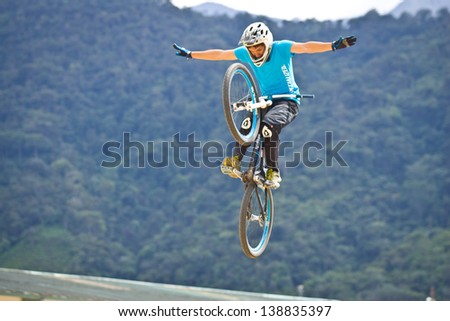 ZAMORA REGION, ZAMORA, ECUADOR-APRIL 27:Rider Juan Alfonso Reece does mountain bike jump tricks in Zamora, Ecuador on April 27, 2013. Extreme sports demonstrations were part of tourism conference.