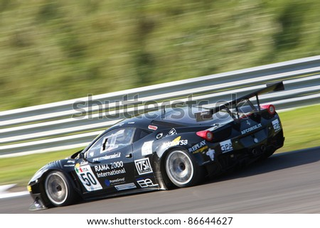 ZANDVOORT, THE NETHERLANDS - OCTOBER 14: Francesco Castellacci and Federico Leo in the AF CORSE FERRARI 458 Italia racing on October 14, 2011 in the European GT3 in Zandvoort, The Netherlands