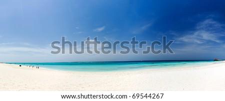 Zanzibar beach, white sand, blue sky, clear water