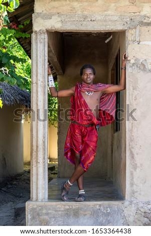 Zanzibar, Tanzania - january 03, 2020 : African man masai dressed in traditional clothes on the street in Stone Town on the island of Zanzibar, Tanzania, East Africa
