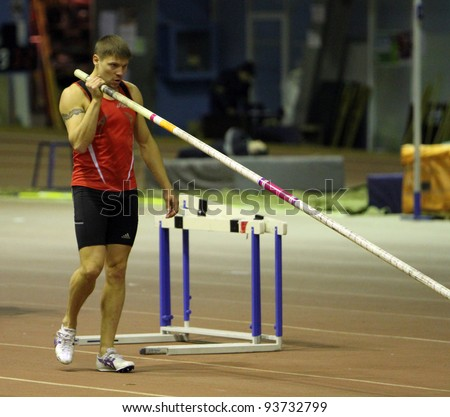 ZAPORIZHIA, UKRAINE - JAN.27: Denys Yurchenko on the Ukrainian Cup in Athletics, on January 27, 2012 in Zaporizhia, Ukraine. He won bronze medal in the pole vault event at  Summer Olympics in Beijing.