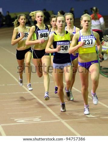 ZAPORIZHIA,UKRAINE - JAN 31: (L-R) Suroedova Irina, Nedashkivska Nina, Statkevich Inna run the 800 m. race on Ukrainian Junior Track and Field Championships on January 31, 2012 in Zaporizhia, Ukraine