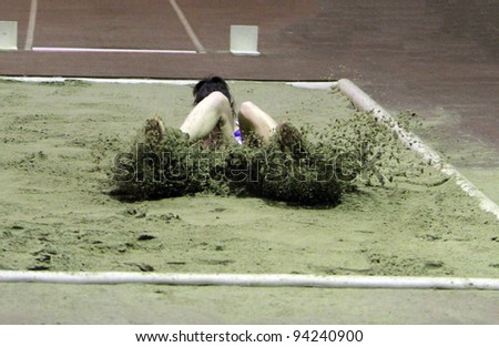 ZAPORIZHIA, UKRAINE - JAN 27: Ruslana Tsihotska compete in the triple jump with second result 13. 80 m., during the Ukrainian Cup in Athletics on January 27, 2012 in Zaporizhia, Ukraine.