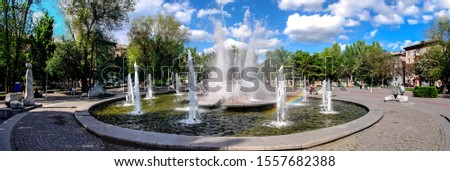Zaporizhzhia City, the central Mayakovskogo square and the Fountain of Life dedicated to the heroes-liquidators of the Chernobyl accident. Summer in Zaporizhia (or Zaporozhye), a rainbow in the spray.