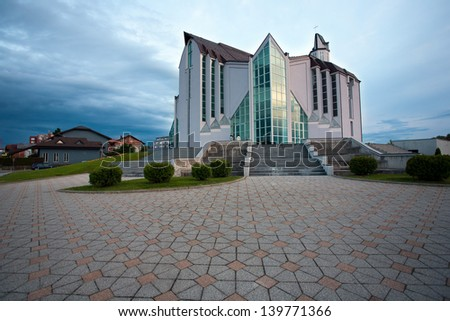 ZAPRESIC, CROATIA - MAY 21: Modern new Zapresic church exterior on May 21, 2013 in Zapresic, Croatia. The church was being built for 20 years and was consecrated on May 26.