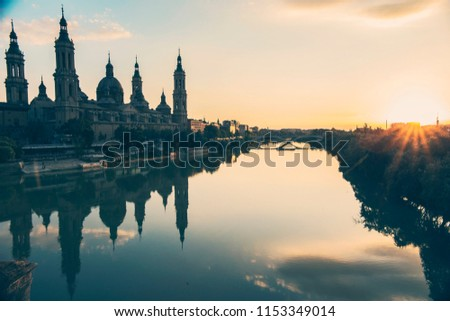 Zaragoza, Spain - July 2018: The Cathedral-Basilica of Our Lady of the Pillar at sunset,  Roman Catholic church in the city of Zaragoza, Aragon  #1153349014