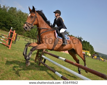 ZAVADA , SLOVAKIA - AUGUST 28: Lucia Krispinska from Slovakia participates in the Grand Prix show jumping  August 28, 2011 in Zavada, Slovakia.