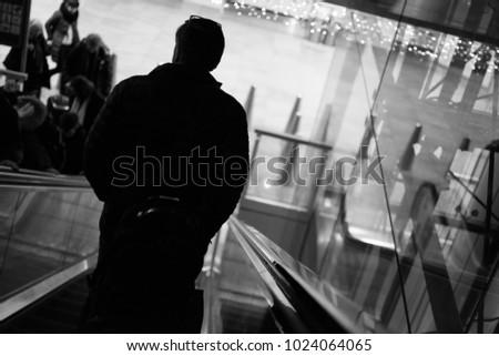 Zaventem, Vlaams Brabant / Belgium - 12 08 2017: Traveler on the escalator heading towards their gate #1024064065