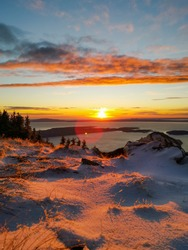 ZAVIZAN - 26.09.2020. Early snow in the Northern Velebit National park in Croatia. Beautiful sunset and view of the Adriatic sea