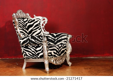 zebra chair isolated on red