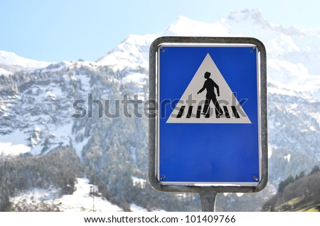 Zebra crossing road sign against mountain scenery