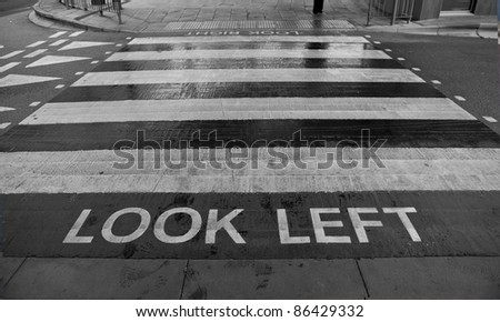 Zebra crossing with look left sign