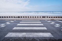 Zebra crosswalk on ocean ocean promenade.