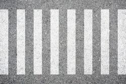 Zebra crosswalk on the road for safety when people walking cross the street.