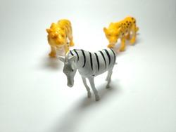 Zebra, Tiger and Cheetah - Miniature Plastic Toy Animals on white background