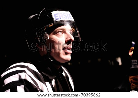 ZELL AM SEE, AUSTRIA - FEB 1: Austrian National League. Referee Roland Altersberger during light out break. Game EK Zell am See vs ATSE Graz (Result 4-1) on February 1, 2011 at hockey rink Zell am See