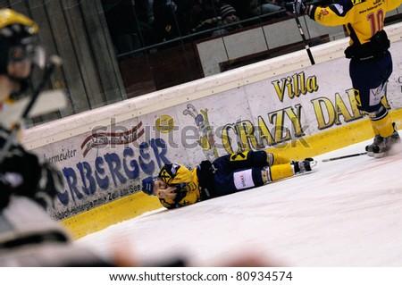 ZELL AM SEE, AUSTRIA - FEB 22: Austrian National League. Stefan Uhl injured after a cheap shot. Game EK Zell am See vs. VEU Feldkirch (Result 3-1) on February 22, 2011 at hockey rink of Zell am See