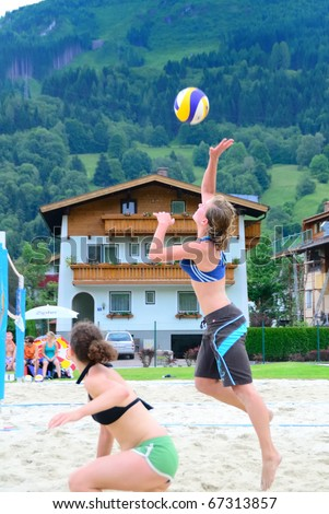 ZELL AM SEE, AUSTRIA - JUNE 26: Walker and Dusek in a preliminary game at the Beach City 2010, the biggest amateur Beach Volleyball Tournament in Austria. June 26, 2010 in Zell am See, Austria