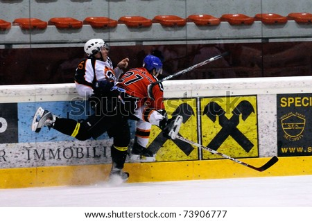 ZELL AM SEE, AUSTRIA - MARCH 19: Salzburg hockey League. Hard hit by Meixner leading to major penalty. SV Schuettdorf vs Salzburg Sud (Result 10-4) on March 19, 2011 at the hockey rink of Zell am See.