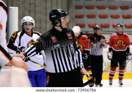 ZELL AM SEE, AUSTRIA - MARCH 19: Salzburg hockey League. Linesman trying to calm down benches. Game SV Schuettdorf vs Salzburg Sued (Result 10-4) on March 19, 2011, at the hockey rink of Zell am See.