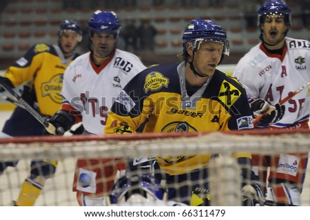 ZELL AM SEE, AUSTRIA - NOVEMBER 30: Austrian National League. Jari Suorsa in front of Keeper Seidl. Game EK Zell am See vs. ATSE Graz (Result 0-4) on November 30, 2010, at hockey rink of Zell am See - stock photo