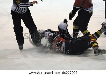 ZELL AM SEE, AUSTRIA - NOVEMBER 28: Salzburg hockey League. Fight between Gollackner and Hahn. Game SV Schuettdorf vs Devils Salzburg  (Result 2-13) on November 28, 2010, at hockey rink of Zell am See, Austria - stock photo