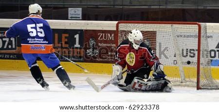 ZELL AM SEE, AUSTRIA - SEPTEMBER 30: Austrian Icehockey Classic Tournament. Aaltonen scores against Goalie Hochwimmer. Zell am See Oldies vs. Pallojussit (3-3) on September 30, 2010 in Zell am See