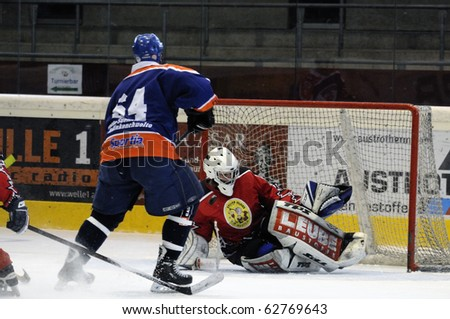 ZELL AM SEE, AUSTRIA - SEPTEMBER 30: Austrian Icehockey Classic Tournament. Action in front of Goalie Hochwimmer. Game Zell am See Oldies vs. Pallojussit (Result 3-3) September 30, 2010 in Zell am See, Austria.