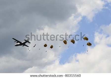 ZELTWEG, AUSTRIA - JULY 01: paratroops of the Austrian army jumping from a Hercules C 130 aircraft by airshow - airpower11 - on July 01, 2011 in Zeltweg, Austria