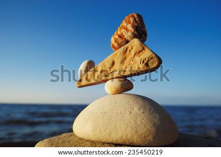 Zen balance of the stones on the seacoast
