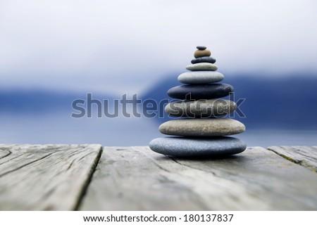 Zen Balancing Rocks o a Deck, New Zealand