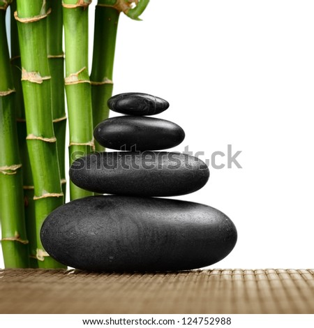 zen basalt stones and bamboo on the white