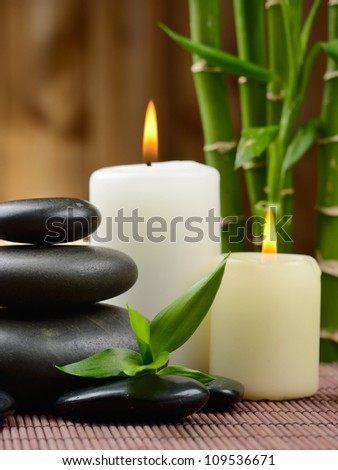 zen basalt stones and candle on the wood
