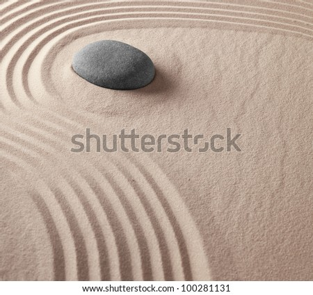 zen buddhism spiritual japanese rock garden abstract harmony and balance concept for purity concentration meditation and spa relaxation sand and stone background