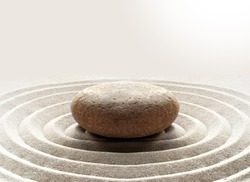 zen garden meditation stone background with stones and lines in sand for relaxation balance and harmony spirituality or spa wellness.